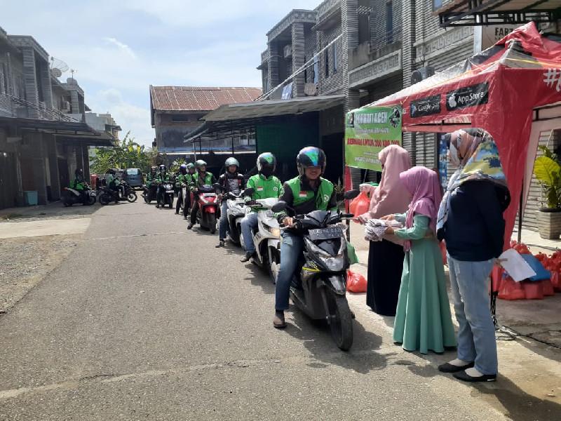FORHATI Aceh Gelar Aksi Bagi Sembako Untuk Ojol di Banda Aceh