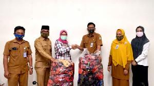 Dukung GEMAS, Pegadaian Syariah Aceh Serahkan 1.500 Masker ke Disdikbud Banda Aceh