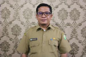 Sekretaris Dinsos Aceh: Tetap Taat Protkes Saat Sedang Mengantri Bansos